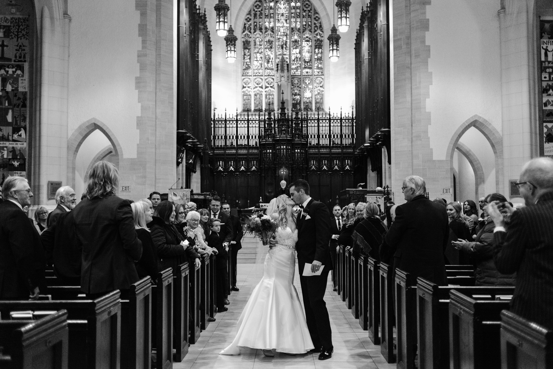 Couples first kiss after being married at Metropolitan United Church